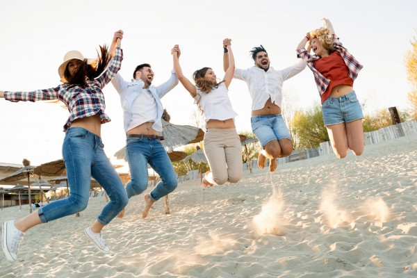 Group of friends on beach having fun